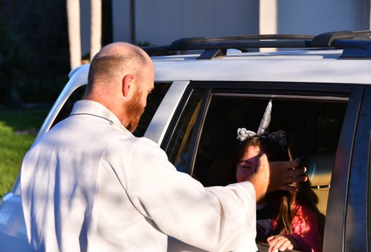 """File: Advent Lutheran Church in Suntree (and their sister church in Melbourne Beach) held drive through services """"Ashes and a prayer"""" to accommodate people's busy lives."""