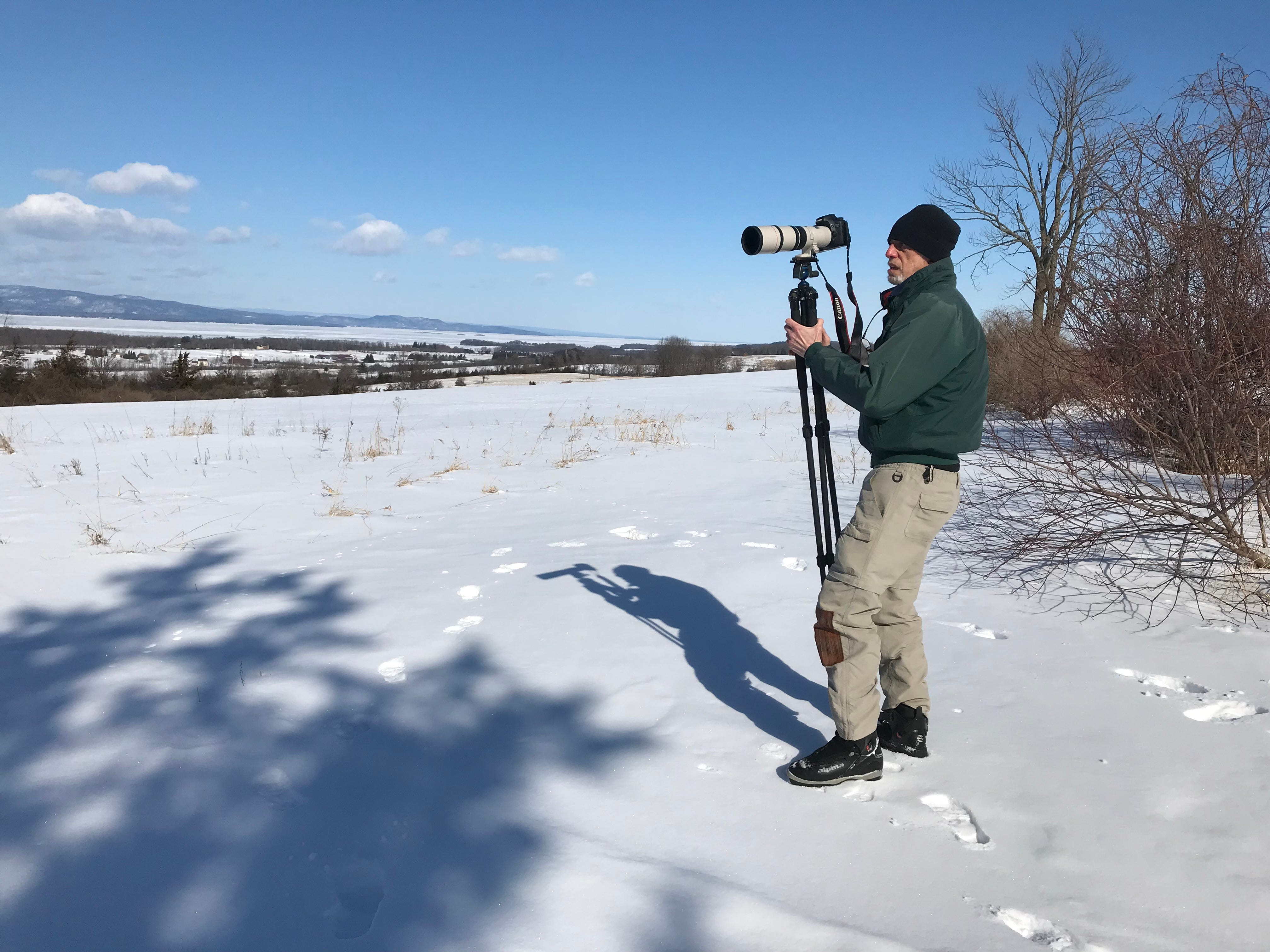 Bob Dill of Burlington prepares to photograph Lake Champlain ice and open water west of Shelburne on Wednesday, March 6, 2019.