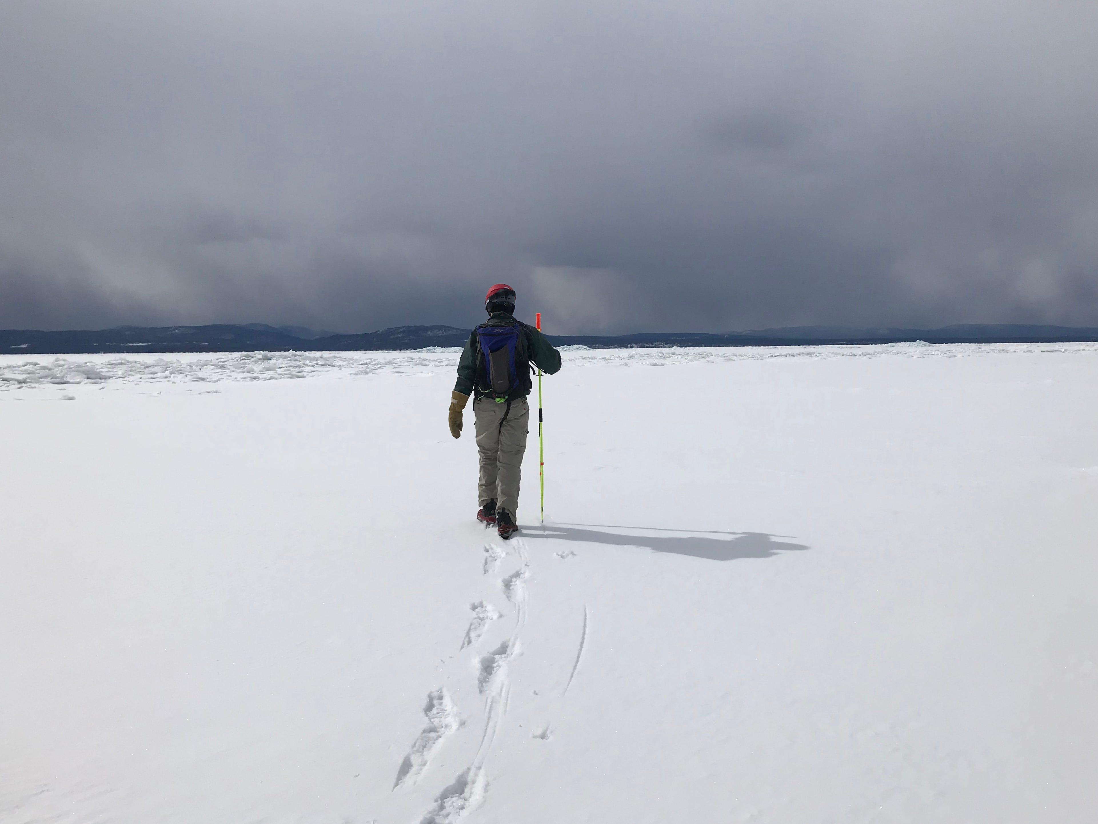 Bob Dill of Burlington walks along Lake Champlain's eastern shore Wednesday, March 6, 2019.