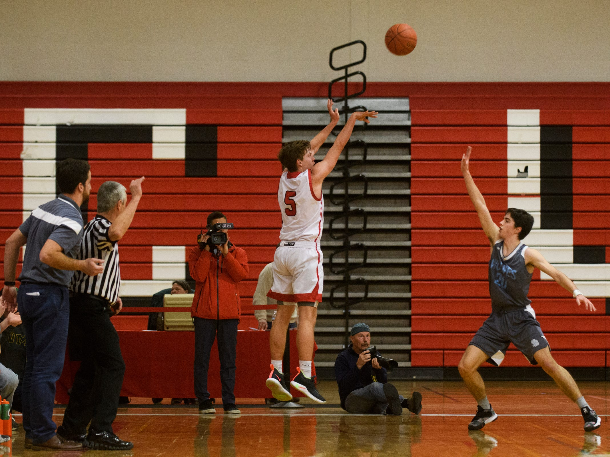 CVU's Ethan Harvey (5) shoots a three pointer during the boys basketball game between he South Burlington Wolves and the Champlain Valley Union Redhawks at CVU High School on Tuesday night March 5, 2019 in Hinesburg, Vermont.