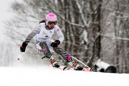 Lyndon's Lena Sauter swept the giant slalom and slaom races at the state championships this week, completing an undefeated season.