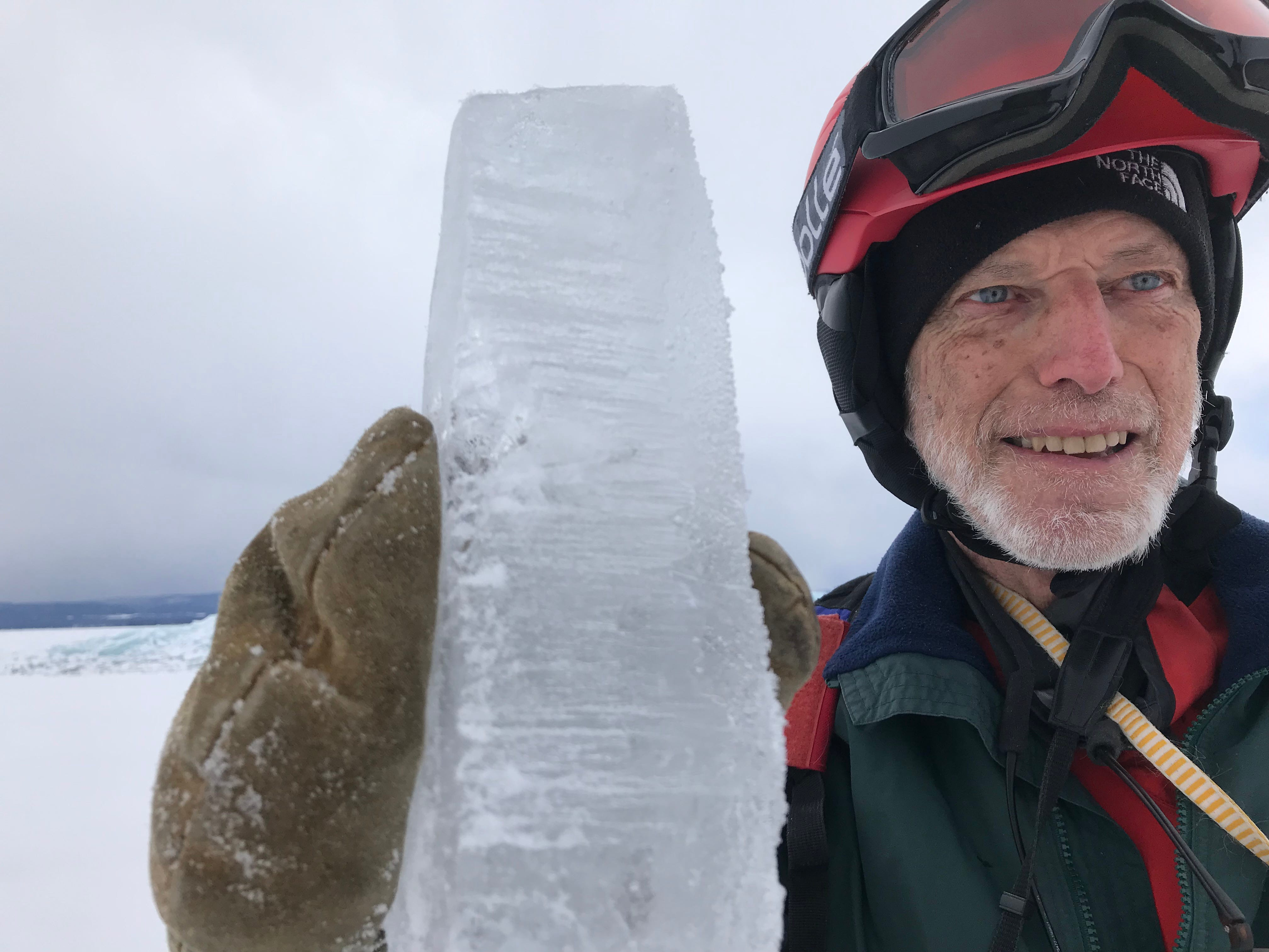 Bob Dill of Burlington holds a three-inch thick block of ice — part of a fragment that thrust itself onto Lake Champlain's ice shelf — while on a hike off Colchester on Wednesday, March 6, 2019.
