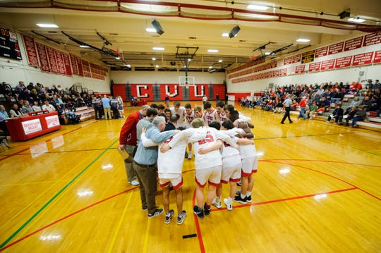 CVU huddles together during the boys basketball game between he South Burlington Wolves and the Champlain Valley Union Redhawks at CVU High School on Tuesday night March 5, 2019 in Hinesburg, Vermont.