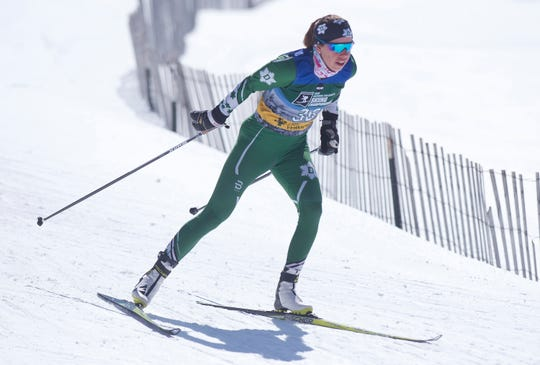 Dartmouth's Katherine Ogden, from Landgrove, Vermont, cruises into a turn of the women's 5K freestyle at the 2019 NCAA ski championships in Stowe on Wednesday, March 6, 2019.