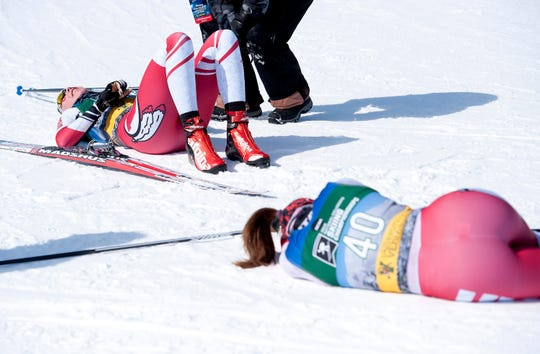 Utah's Julia Richter, left, and teammate Guro Jordheim catch their breath on the snow after the women's 5K freestyle at the 2019 NCAA ski championships in Stowe on Wednesday, March 6, 2019.