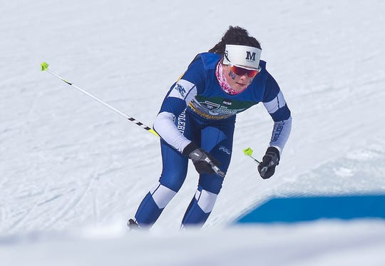 Middlebury's Avery Ellis, a North Country Union High School grad, charges onto the course for the women's 5K freestyle at the 2019 NCAA ski championships in Stowe on Wednesday, March 6, 2019.