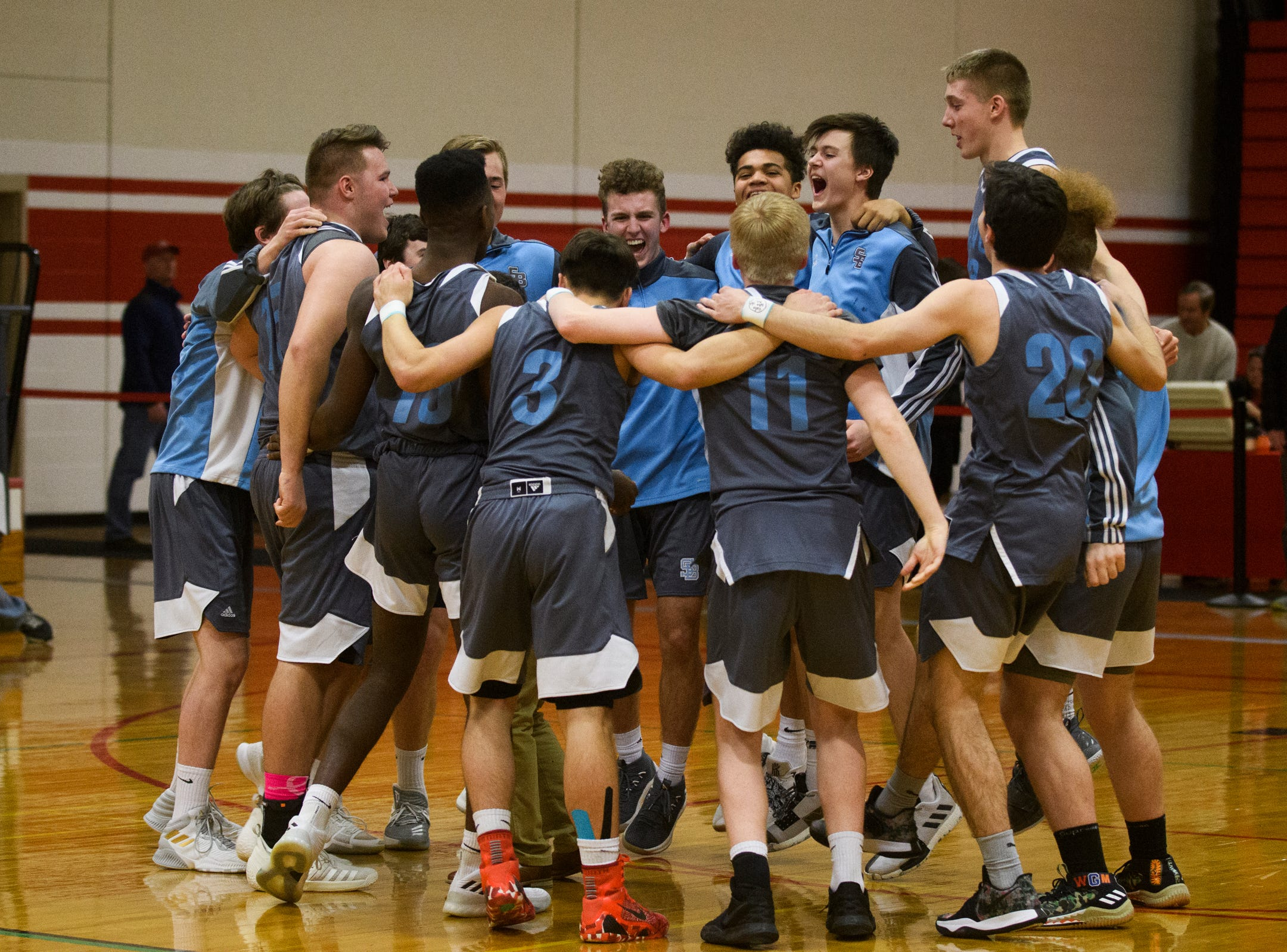 South Burlington huddles together during the boys basketball game between he South Burlington Wolves and the Champlain Valley Union Redhawks at CVU High School on Tuesday night March 5, 2019 in Hinesburg, Vermont.