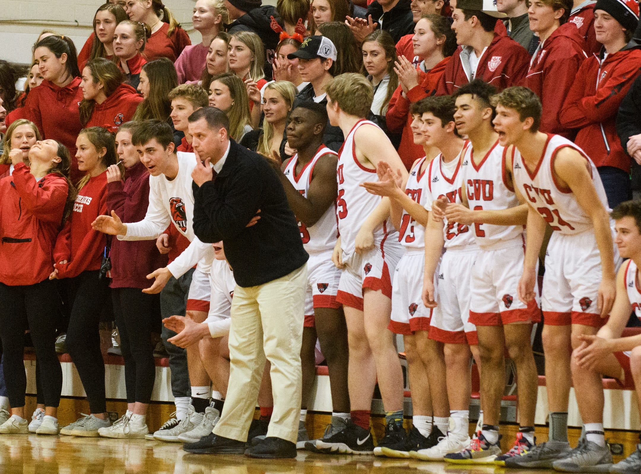 CVU head coach Michael Osborne watches the action on the court during the boys basketball game between he South Burlington Wolves and the Champlain Valley Union Redhawks at CVU High School on Tuesday night March 5, 2019 in Hinesburg, Vermont.
