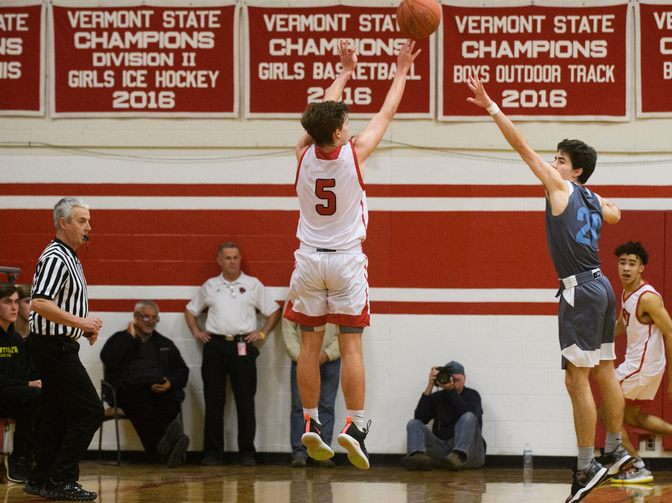 CVU's Ethan Harvey (5) shoots the ball during the boys basketball game between he South Burlington Wolves and the Champlain Valley Union Redhawks at CVU High School on Tuesday night March 5, 2019 in Hinesburg, Vermont.
