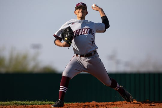 Agua Dulce's Randal Garza throws a pitch during the first inning of their game against Refugio at the Fairgrounds Field, in Robstown on Tuesday, March 5, 2019.
