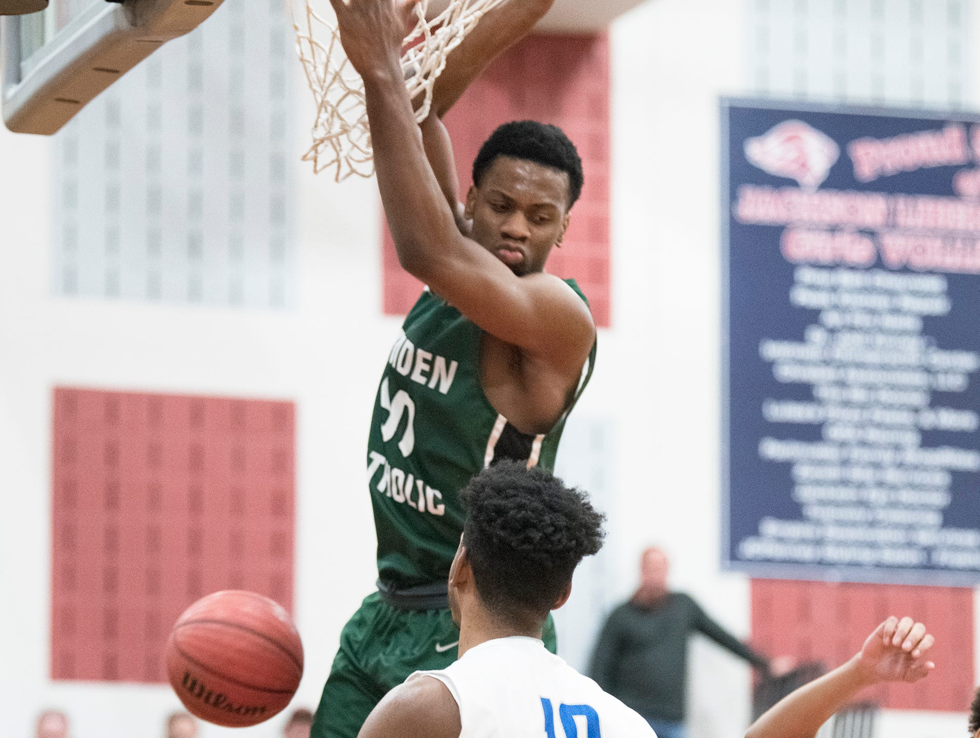 Camden Catholic's Uche Okafor dunks over Paul VI's Jordany Pierre during the Non-Public A South boys basketball final played at Jackson Liberty High School on Tuesday, March 5, 2019.
