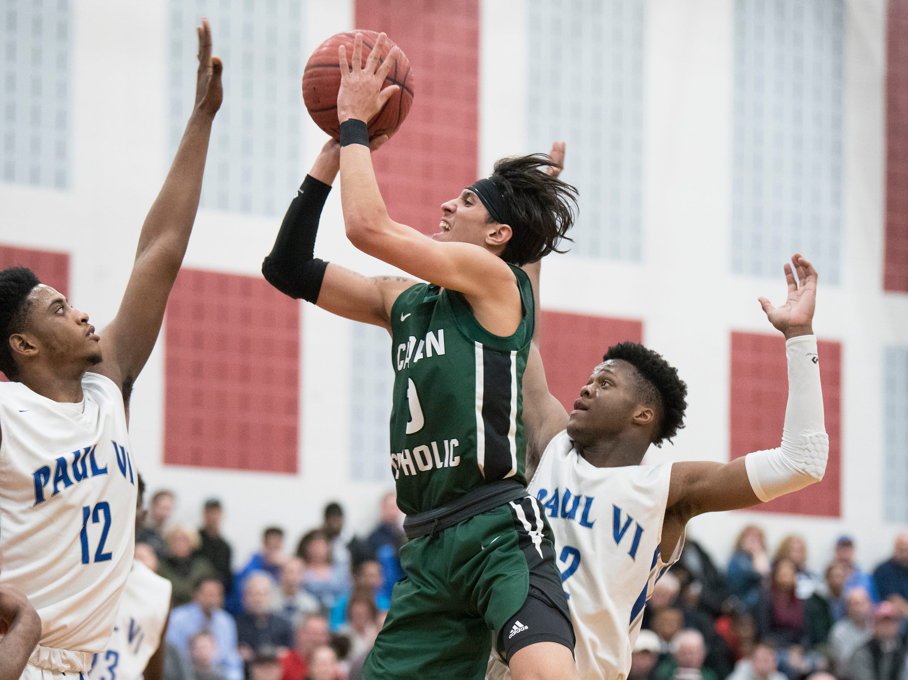 Camden Catholic's Valen Tejada puts up a shot during the 2nd half of Non-Public A South boys basketball final between Camden Catholic and Paul VI played at Jackson Liberty High School on Tuesday, March 5, 2019.