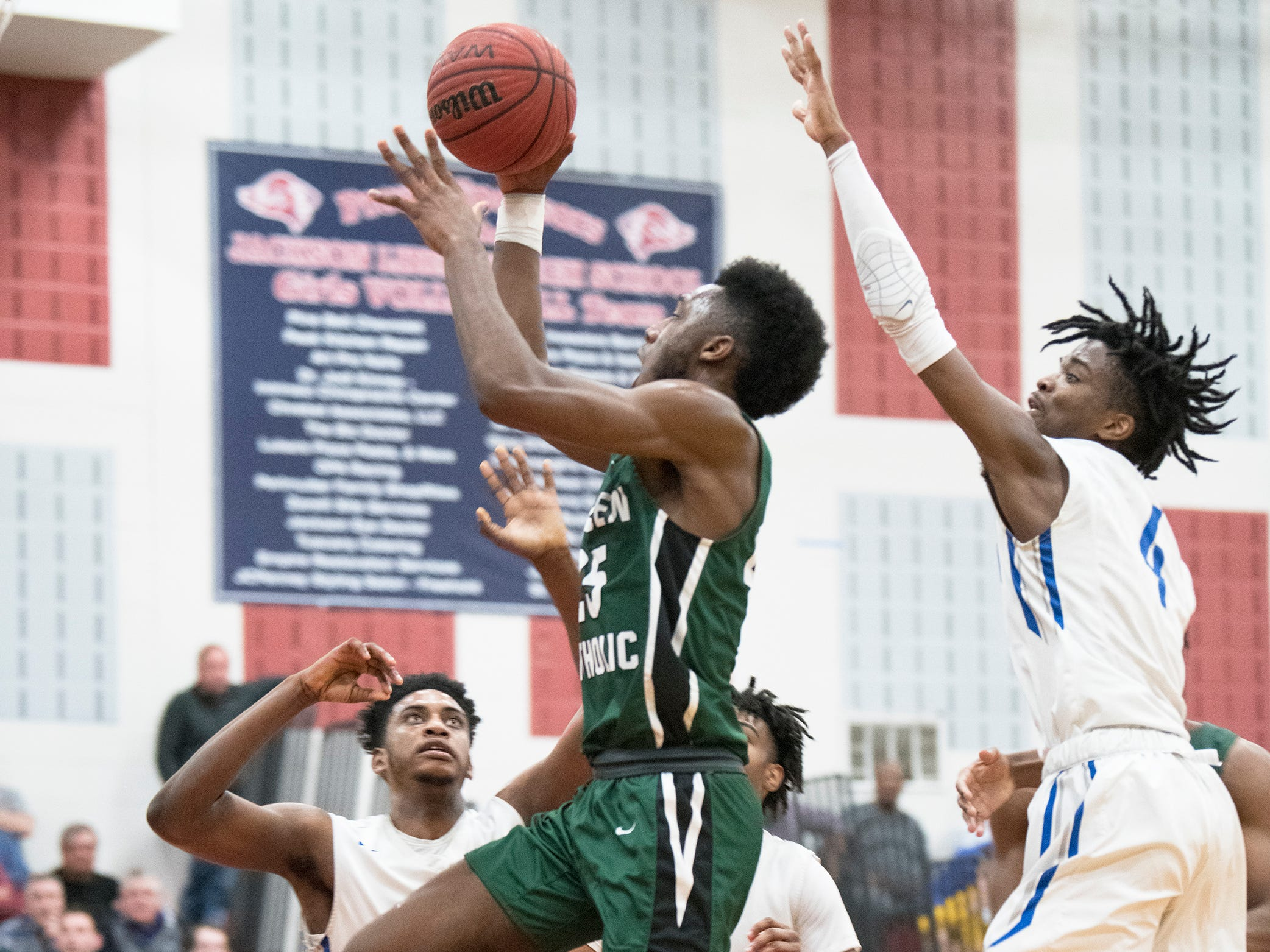 Camden Catholic's Babatunde Ajike puts up a shot during the 2nd half of the Non-Public A South boys basketball final between Camden Catholic and Paul VI played at Jackson Liberty High School on Tuesday, March 5, 2019.