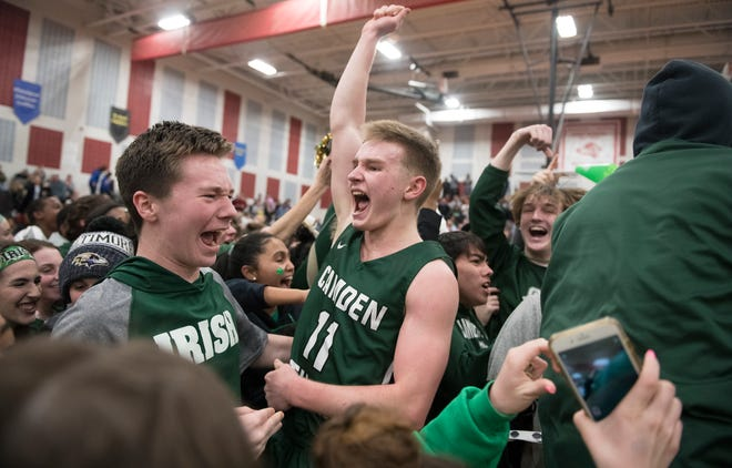 Camden Catholic's Patrick Corbett, center, celebrates with teammates and fans after Camden Catholic defeated Paul VI, 40-34, in the Non-Public A South boys basketball final played at Jackson Liberty High School on Tuesday, March 5, 2019.