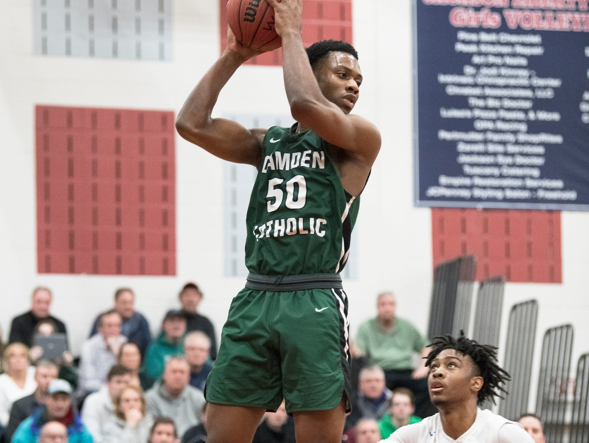 Camden Catholic's Uche Okafor grabs a rebound over Paul VI's Hartnel Haye during the 2nd quarter of the Non-Public A South boys basketball final played at Jackson Liberty High School on Tuesday, March 5, 2019.