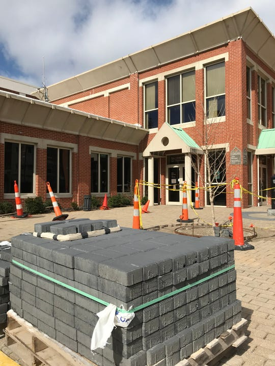 A pallet of pavers sit outside the Ross County Law Enforcement Center and Jail where orange cones block off uncompleted work and cover materials jutting from the ground where lights are supposed to be reinstalled.