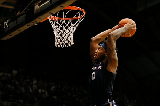 Xavier Musketeers forward Tyrique Jones (0) goes up for a dunk in the second half of the NCAA Big East basketball game between the Butler Bulldogs and the Xavier Musketeers at Hinkle Fieldhouse in Indianapolis, Ind., on Tuesday, March 5, 2019. Xavier's winning streak ended with a 71-66 loss to Butler.