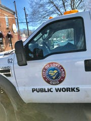 Loveland's public works director has his own blacktop-sealing business.