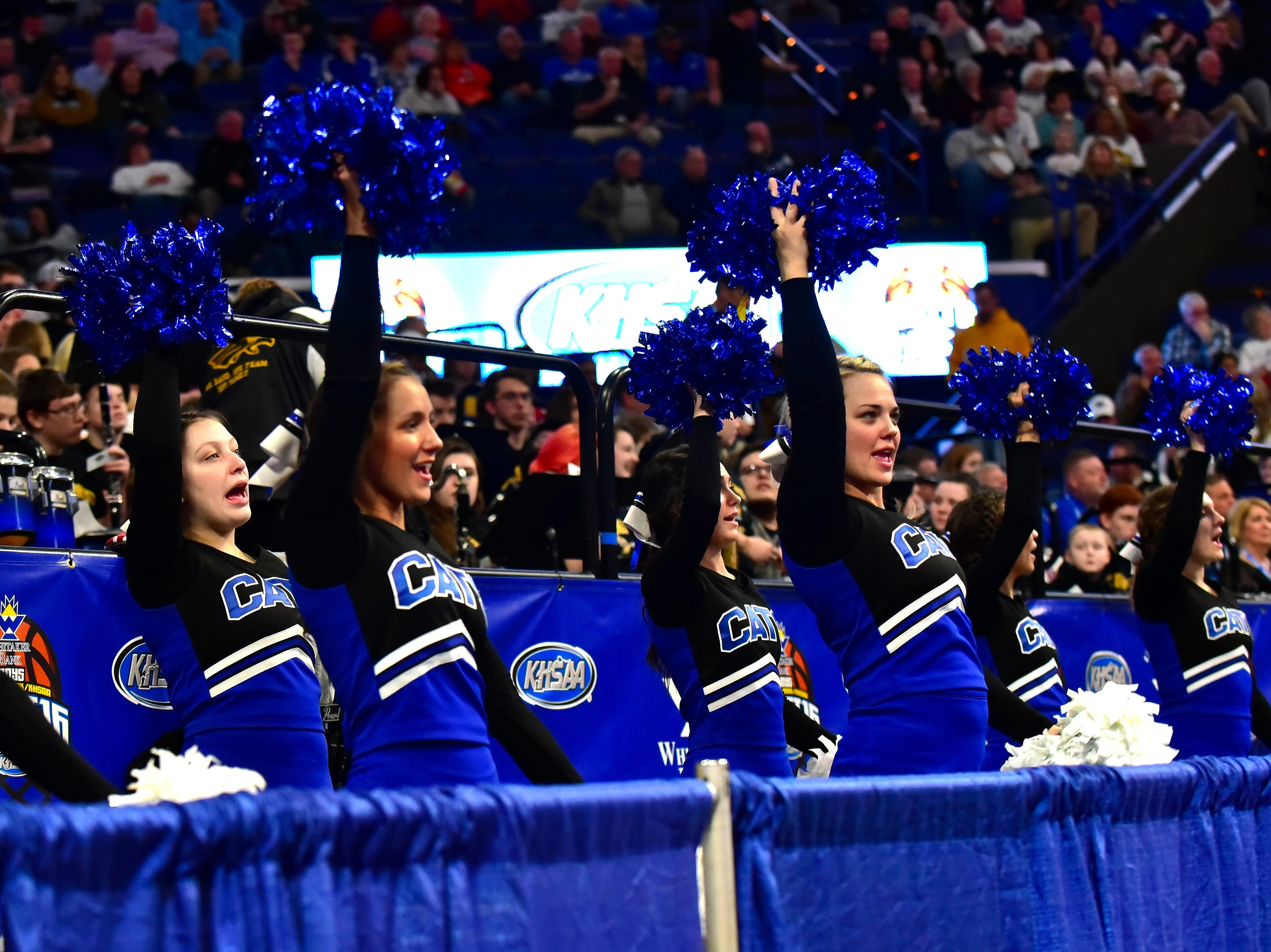 The Walton Verona cheerleaders celebrate the Bearcats win in round one at the KHSAA Sweet 16 Tournament at Rupp Arena in Lexington, KY, March 6, 2019