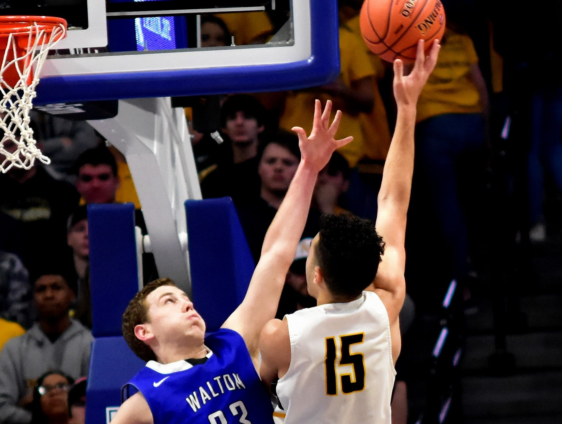 Walton Verona's Grant Grubbs tries to block an incoming Knox Central jumper at the KHSAA Sweet 16 Tournament at Rupp Arena in Lexington, KY, March 6, 2019