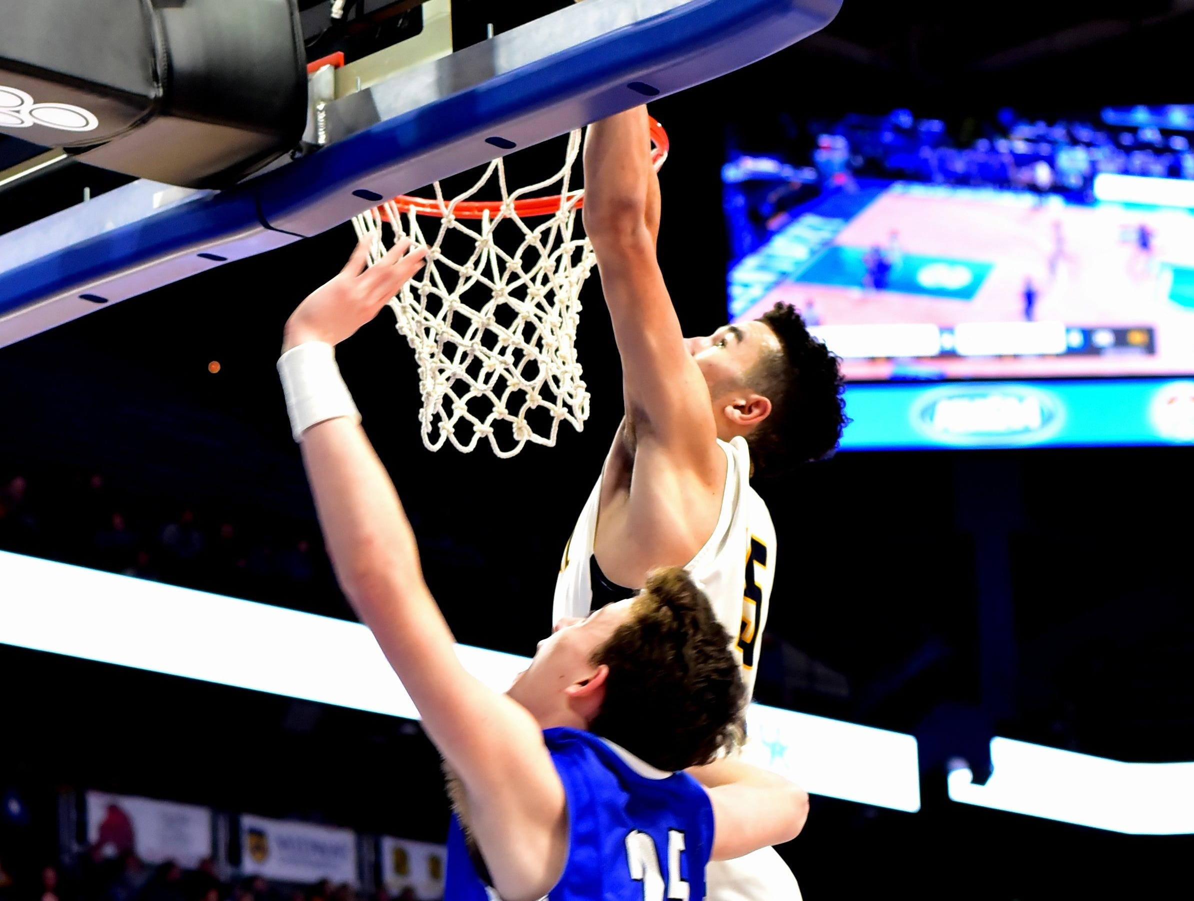 Kameron Pardee  (25) of Walton Verona slids in a left handed layup off of the backboard at the KHSAA Sweet 16 Tournament at Rupp Arena in Lexington, KY, March 6, 2019