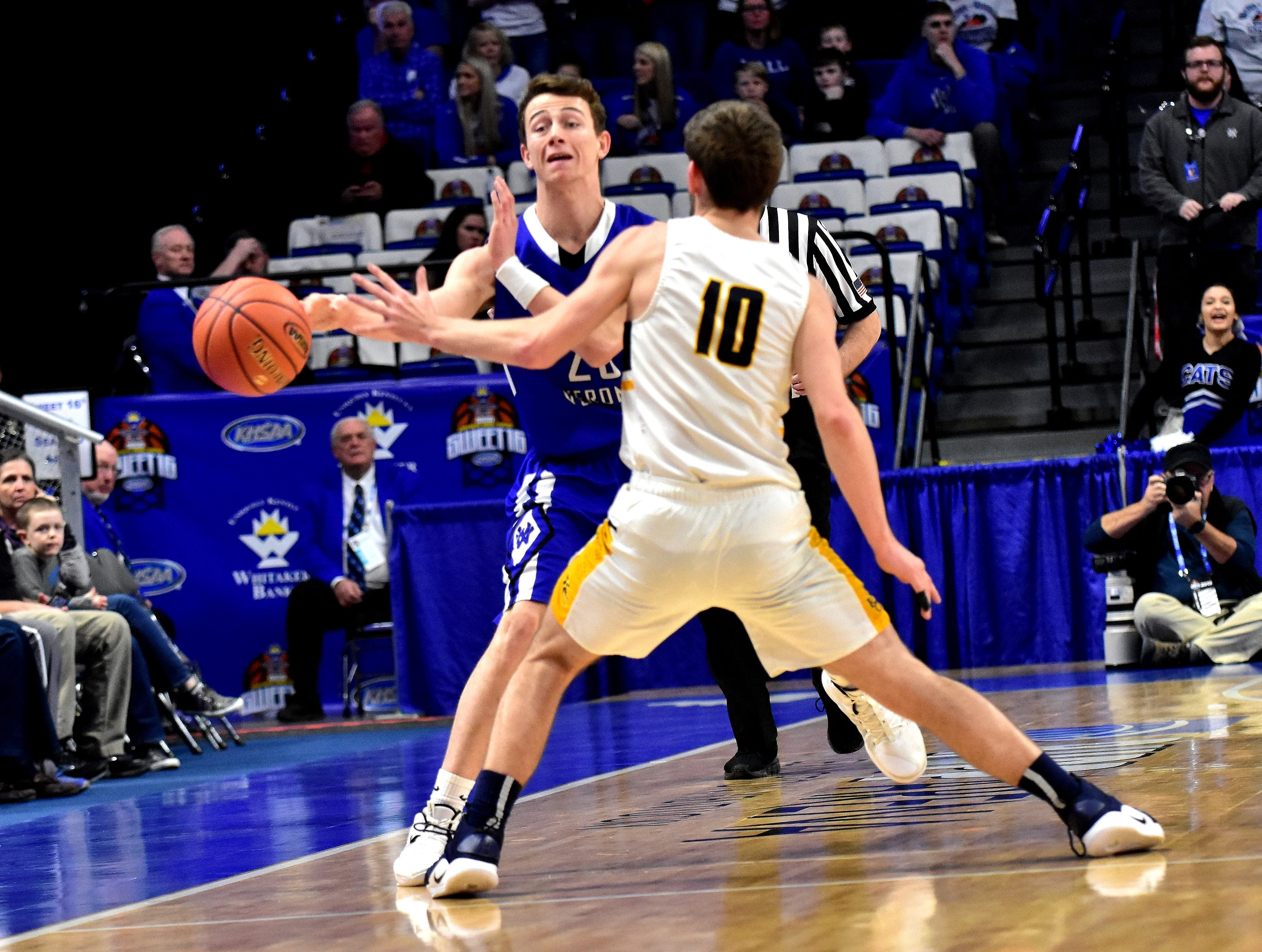 Bryson Stanley passes the ball over the time line for Walton Verona at the KHSAA Sweet 16 Tournament at Rupp Arena in Lexington, KY, March 6, 2019