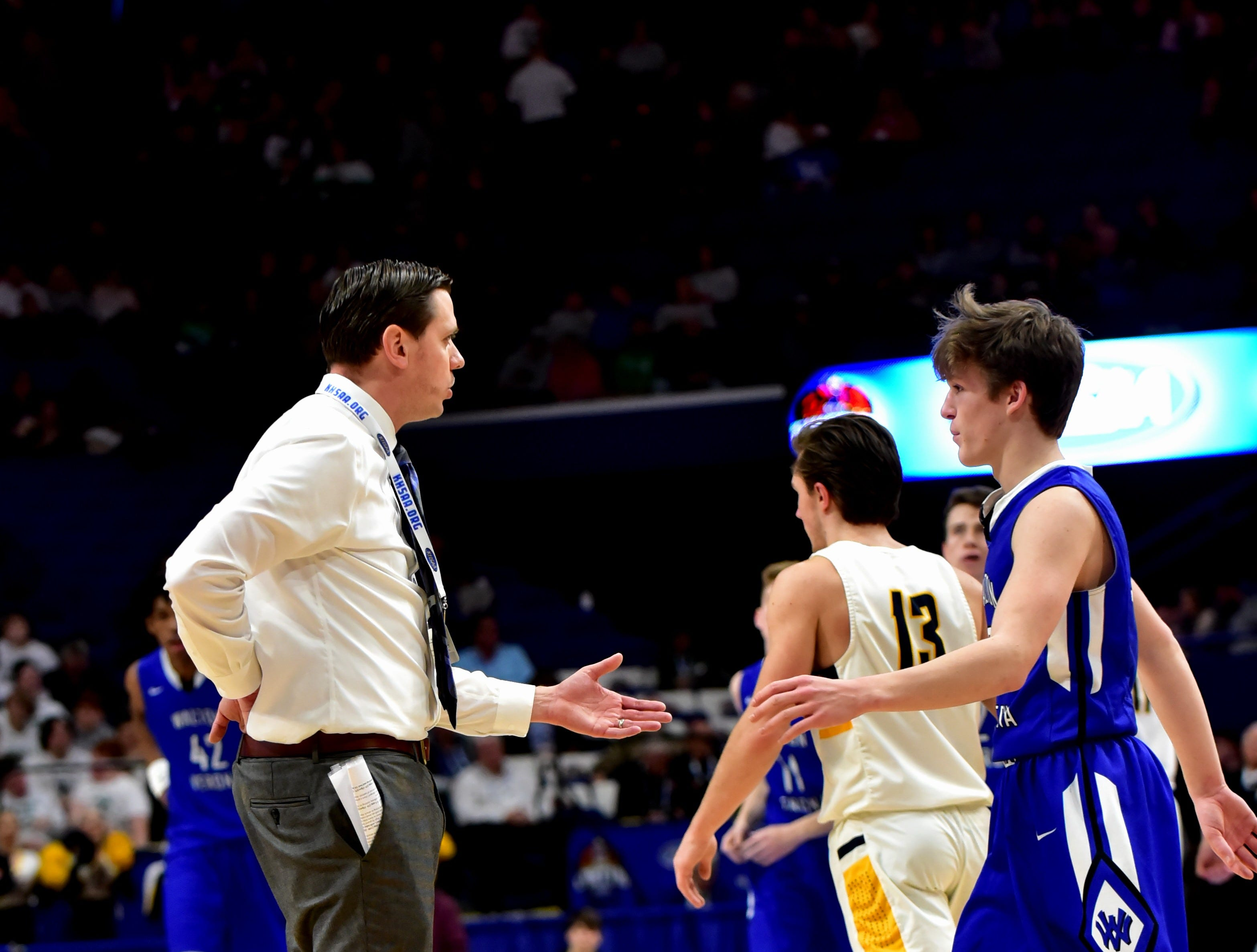 Coach Grant Brannen of Walton Verona congratulates his players after wiing game one at the KHSAA Sweet 16 Tournament at Rupp Arena in Lexington, KY, March 6, 2019