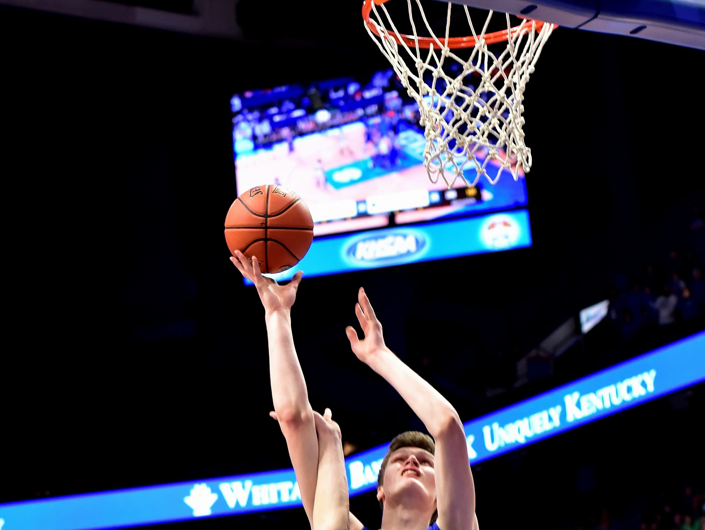 Ethan Brook (1) collects a basket and trip to the free throw line for Walton Verona at the KHSAA Sweet 16 Tournament at Rupp Arena in Lexington, KY, March 6, 2019