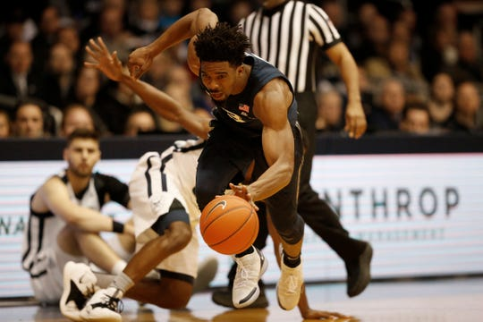 Xavier Musketeers guard Quentin Goodin (3) is tripped up on his way to the basket in the first half of the NCAA Big East basketball game between the Butler Bulldogs and the Xavier Musketeers at Hinkle Fieldhouse in Indianapolis, Ind., on Tuesday, March 5, 2019.