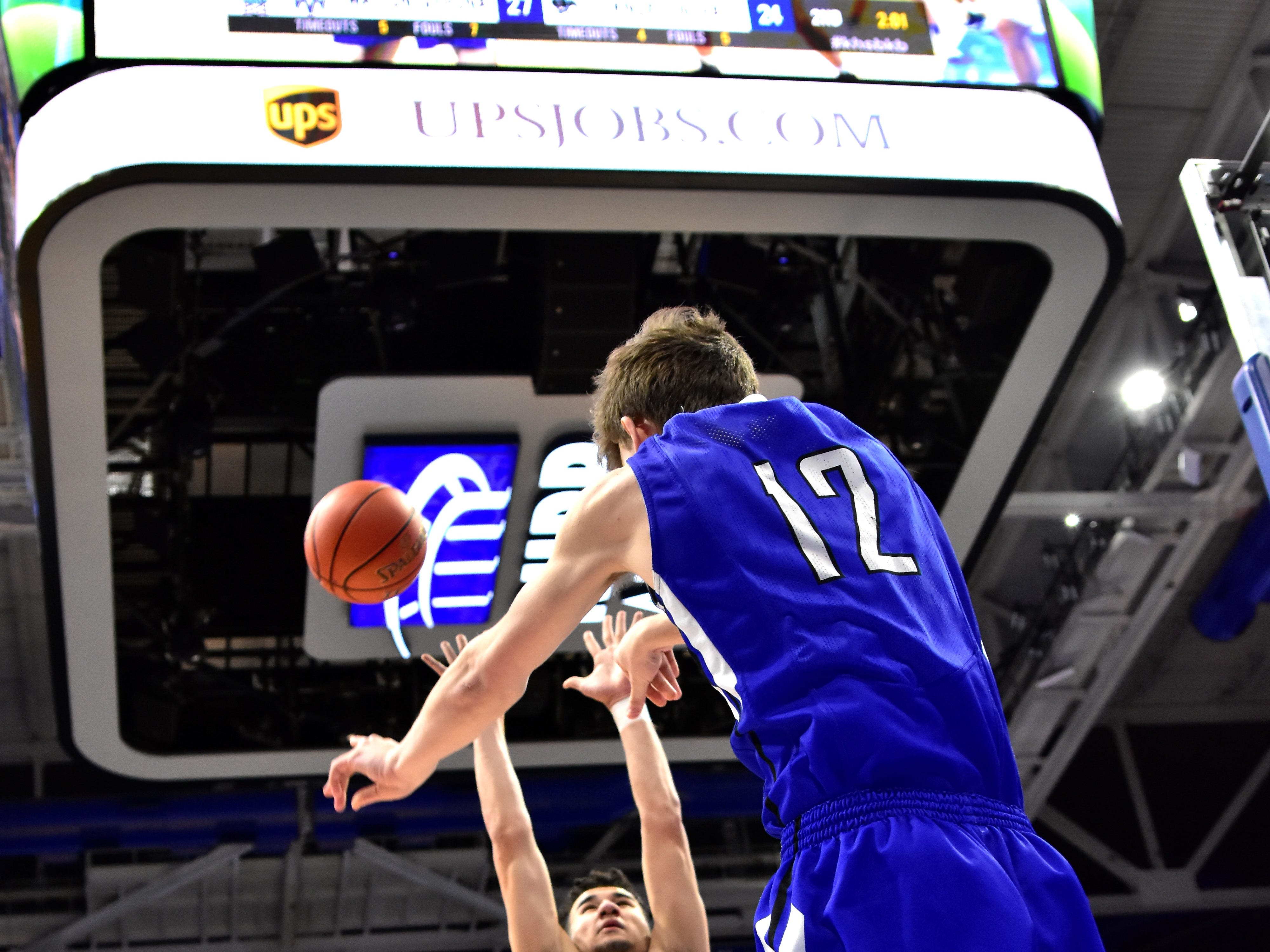Walton Verona's Jack Watson lofts the ball inbounds from the baseline over the Knox Central defense at the KHSAA Sweet 16 Tournament at Rupp Arena in Lexington, KY, March 6, 2019