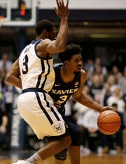Xavier Musketeers guard Quentin Goodin (3) collides with Butler Bulldogs guard Kamar Baldwin (3) on his way down court in the first half of the NCAA Big East basketball game between the Butler Bulldogs and the Xavier Musketeers at Hinkle Fieldhouse in Indianapolis, Ind., on Tuesday, March 5, 2019.