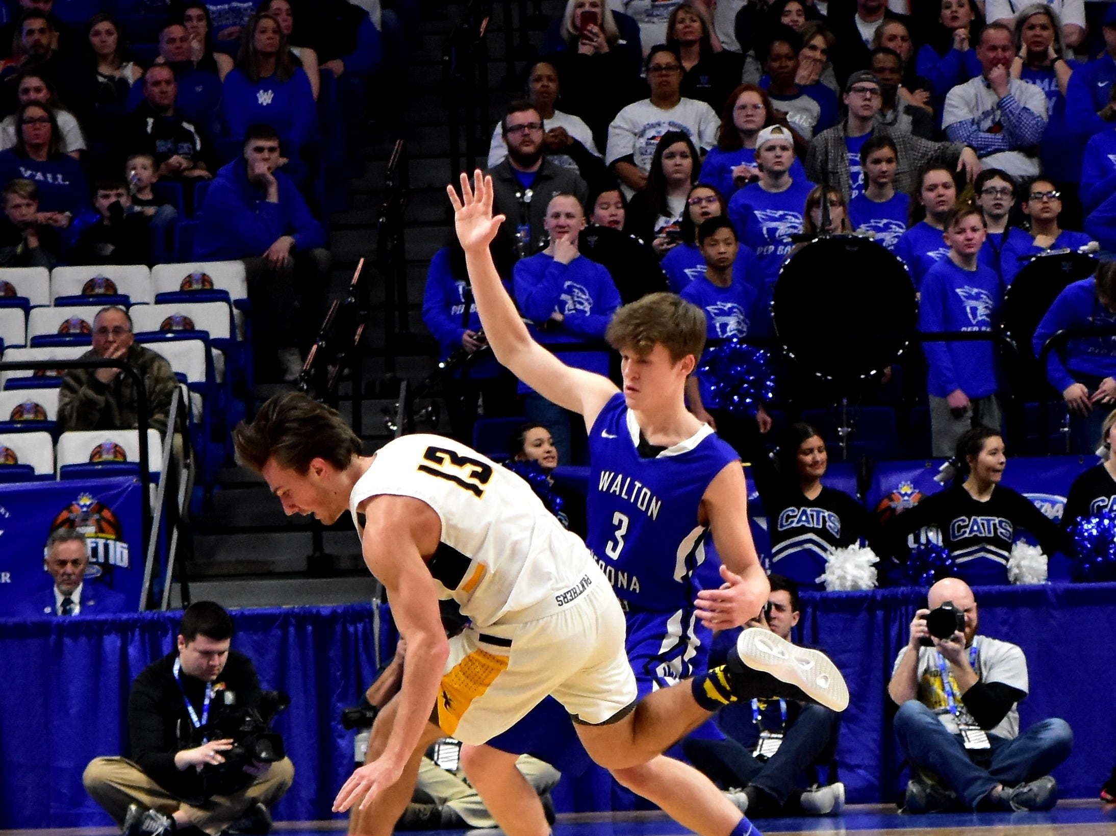 Garrett Jones (3) of Walton Verona traps his offender at mid court for the Bearcats at the KHSAA Sweet 16 Tournament at Rupp Arena in Lexington, KY, March 6, 2019