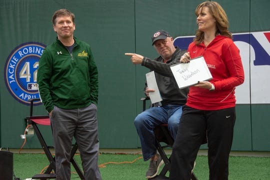 """Sycamore High School varsity baseball coach Pete Muehlenkamp (left) and Fairfield high school varsity softball coach Brenda Steiger (right) play a round of Reds trivia with Reds Hall of Famer Tom Browning at the kickoff event for the 2019 Skyline Chili Reds Futures High School Showcase at the P&G MLB Cincinnati Reds Youth Academy in Roselawn. The question was, """"Who was batting when Tom Browning threw the final strikeout during his perfect game in 1998."""" Answer: Tracy Woodson."""