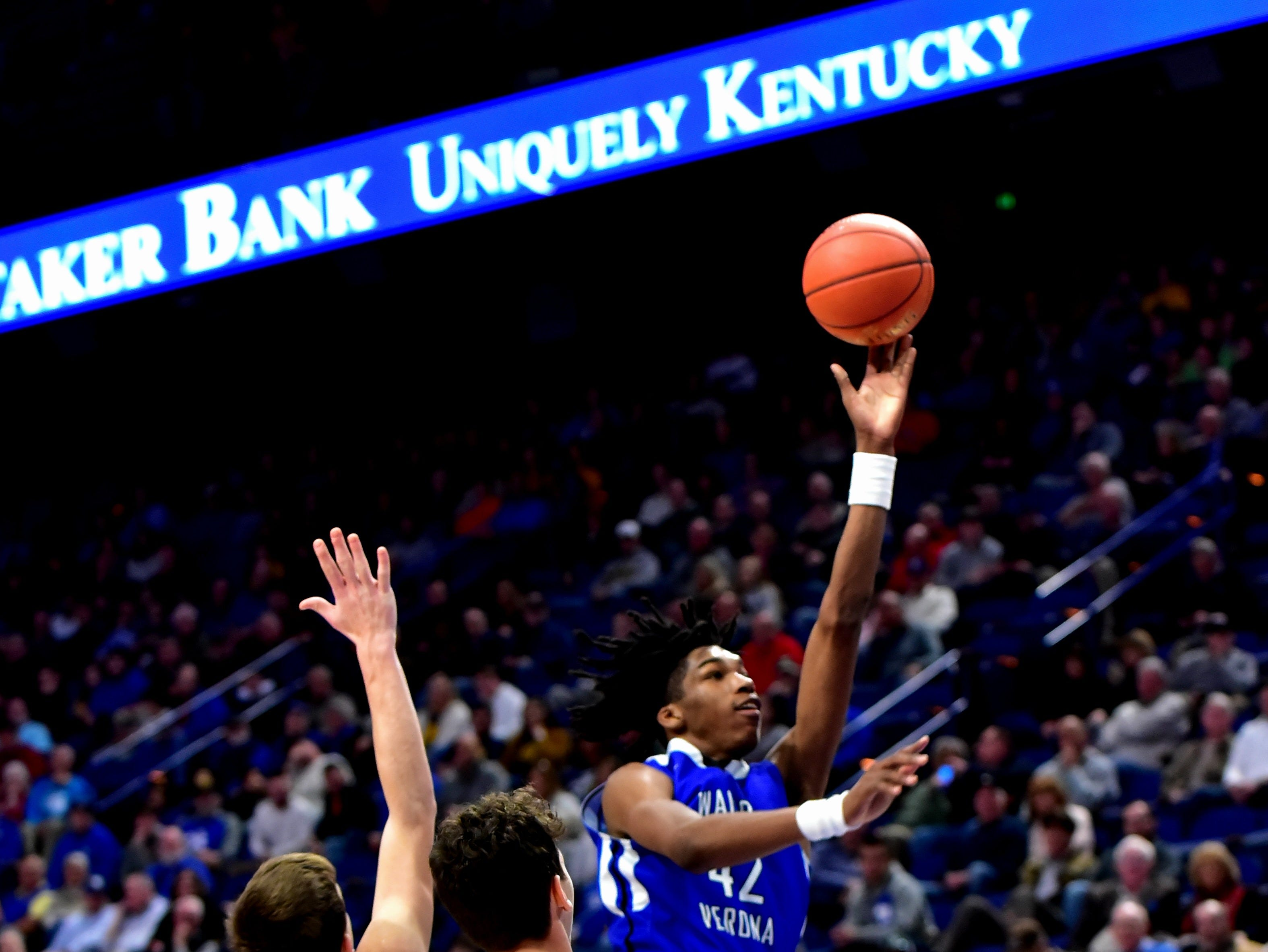 Dieonte Miles (42) of Walton Verona floats home a left handed layup at the KHSAA Sweet 16 Tournament at Rupp Arena in Lexington, KY, March 6, 2019