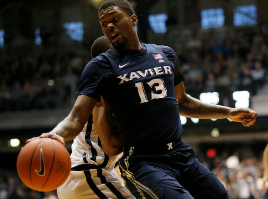 Xavier Musketeers forward Naji Marshall (13) spins around Butler Bulldogs forward Sean McDermott (22) to the basket in the first half of the NCAA Big East basketball game between the Butler Bulldogs and the Xavier Musketeers at Hinkle Fieldhouse in Indianapolis, Ind., on Tuesday, March 5, 2019.