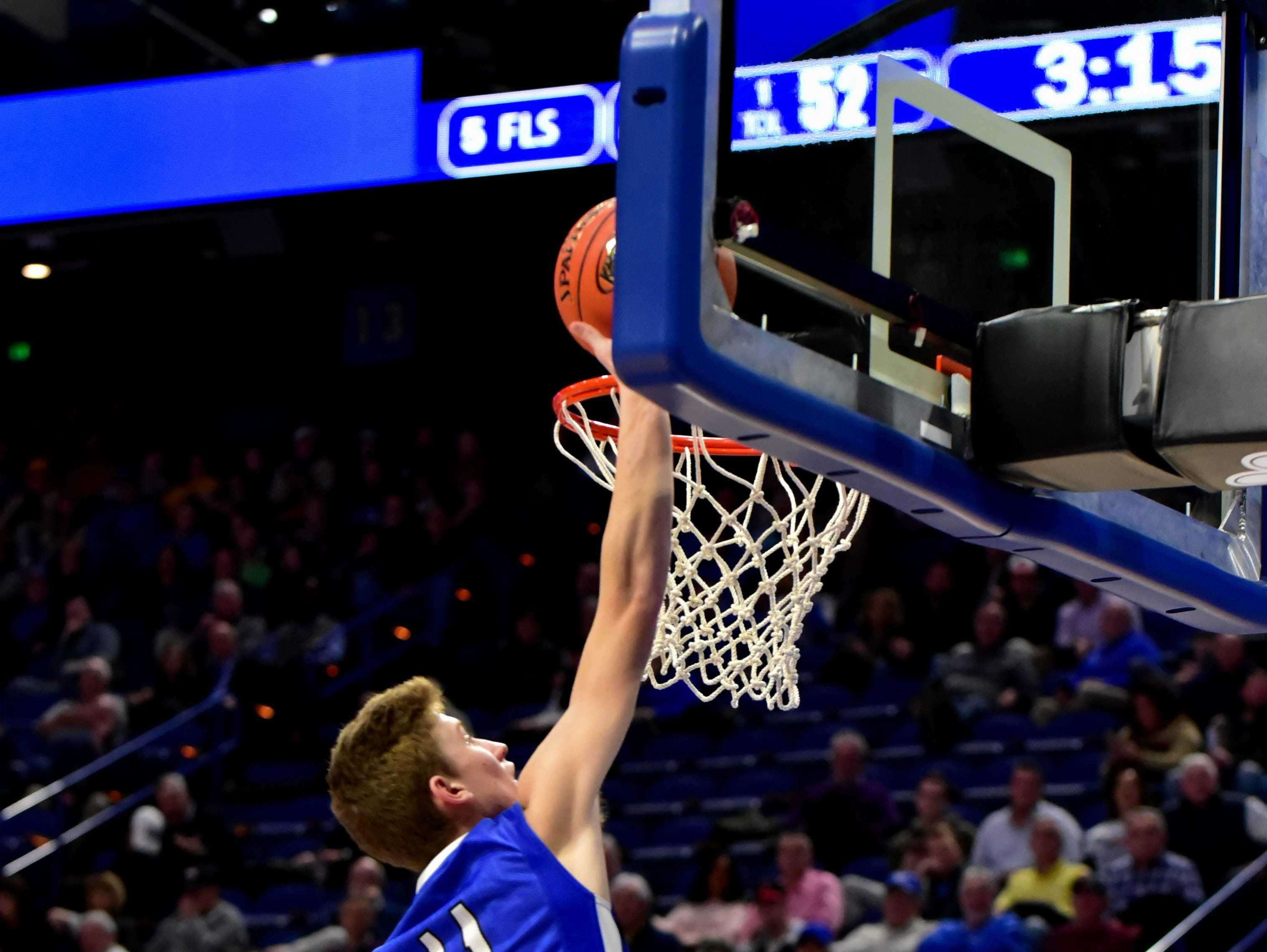 Trey Bonne skies to the hoop for points for the Bearcats as they top Knox Central in first round action at the KHSAA Sweet 16 Tournament at Rupp Arena in Lexington, KY, March 6, 2019