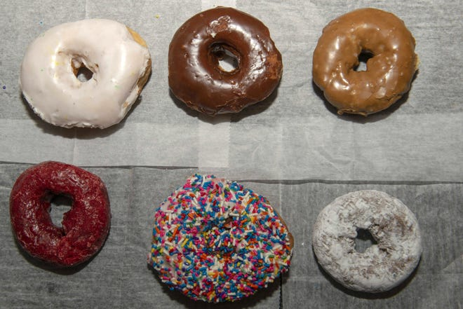 A large group of people swarmed the Holtman's Donut Shop in West Chester on Saturday, forcing staff to call the police due to a lack of social distancing.