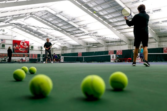 Visitors practice volleying the ball between one another while others occupy the courts at Governor's Indoor Tennis Center in Clarksville, Tenn., Tuesday, March 5, 2019.