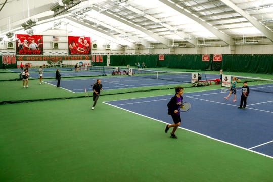Visitors ranging from students to families teaching kids tennis to friend groups utilize the courts at Governor's Indoor Tennis Center in Clarksville, Tenn., Tuesday, March 5, 2019.