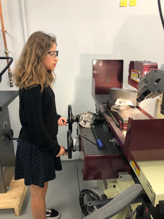 Somerset County Vocational & Technical High School student Anabella Jaime works in the College's Advanced Manufacturing lab.