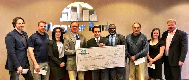 MagyarBank Charitable Foundation President Jay Castillo, center, with recipients of the Foundation's grants.