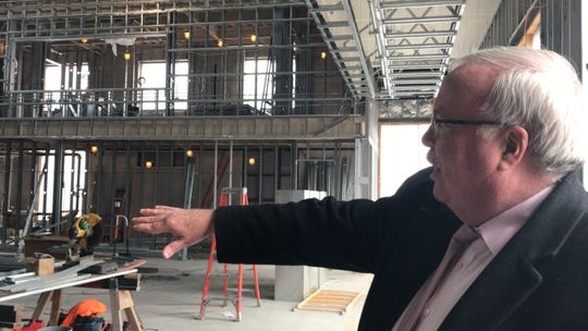 Woodbridge Mayor John E. McCormac is pictured in what will be the theater at the Avenel Performing Arts Center scheduled to open in April.