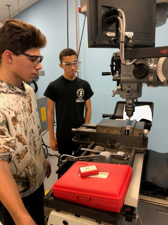 Somerset County Vocational & Technical High School students Nick Corra and Marc Acevedo work in the College's Advanced Manufacturing lab.