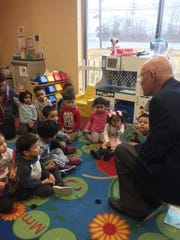 Mayor Dennis Sullivan read to the toddlers, preschoolers and pre-K students atEllie's Academy of Somerville on Friday, March 1.
