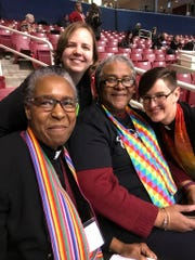 The Rev. Anna Blaedel (right), an openly queer pastor in Iowa City, said they expect to lose their job following the United Methodist Church's vote last week to keep bans on LGBTQ clergy and same-sex marriages.