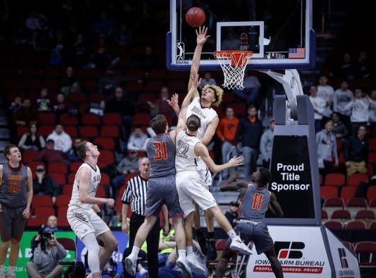 Oskaloosa junior Xavier Foster blocks the shot attempt by Marion senior Mason Rahe late in the fourth quarter of their Class 3A quarterfinal game during the 2019 Iowa high school boys state basketball tournament at Wells Fargo Arena in Des Moines.