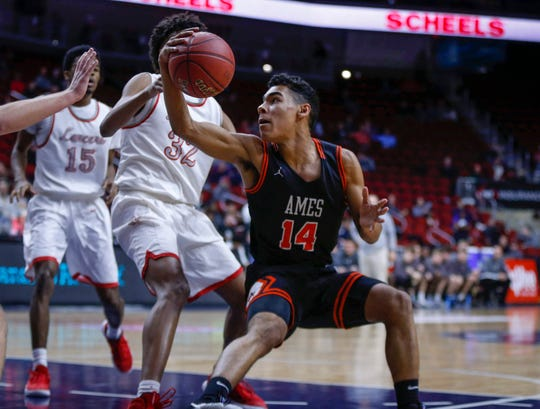 Ames freshman Tamin Lipsey cuts back to get open in the first quarter against North Scott in their Class 4A quarterfinal game during the 2019 Iowa high school boys state basketball tournament at Wells Fargo Arena in Des Moines.