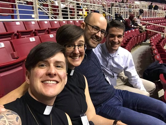 The Rev. Anna Blaedel (second from left), an openly queer pastor in Iowa City, said they expect to lose their job following the United Methodist Church's vote last week to keep bans on LGBTQ clergy and same-sex marriages.