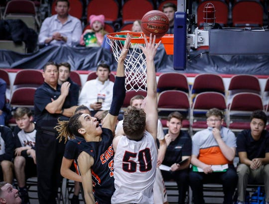Cedar Falls sophomore Chase Courbat puts up a shot under the basket as Sioux City East senior Javonte Keck reaches out to attempt the block in the second quarter of their Class 4A quarterfinal game during the 2019 Iowa high school boys state basketball tournament at Wells Fargo Arena in Des Moines.