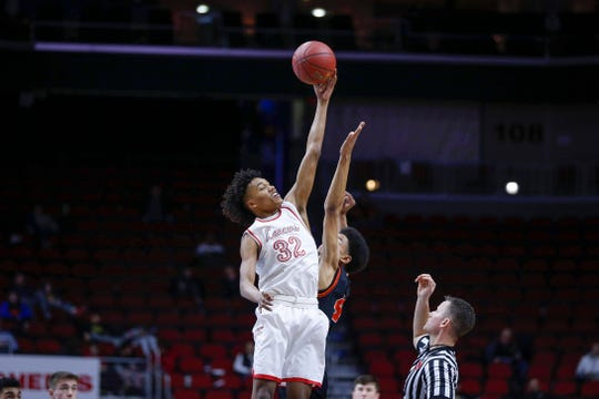North Scott junior Ty Anderson wins the tip off against Ames in their Class 4A quarterfinal game during the 2019 Iowa high school boys state basketball tournament at Wells Fargo Arena in Des Moines.